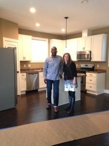 PRG's Executive Director, Kathy Wetzel-Mastel, with General Contractor, Anderson Mitchell of Mitchell Construction, inside 1811 Girard, a PRG Green Homes North project on the 2015 MSP Home Tour.